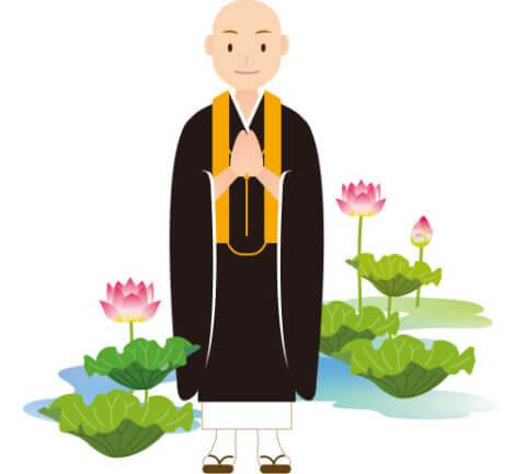 合掌をしながら微笑んでいる仏教僧侶